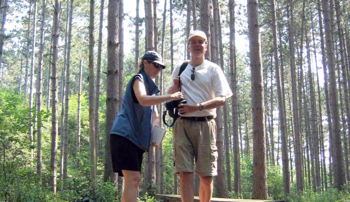 A couple prepares for a hike outside at the Cummings Nature Center