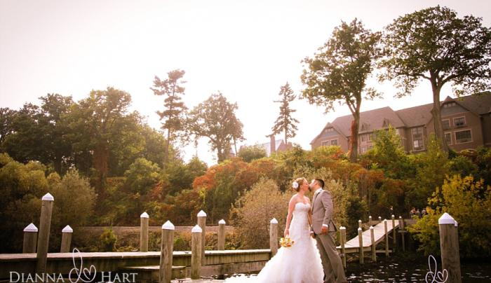 Bride and Groom on a dock at Belhurst Castle