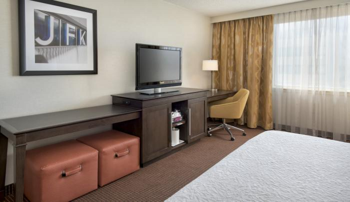 King Bed Guest Room with Entertainment Center