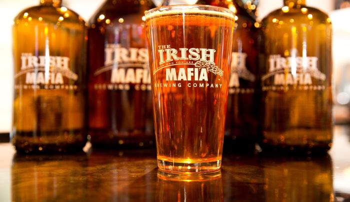 Photo of a cold class of beer from Irish Mafia Brewing Company