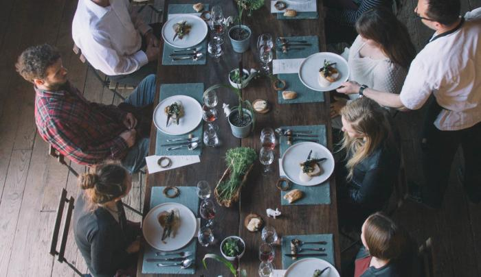 overhead view of the tasting table with a group being served at Ravines Wine Cellars