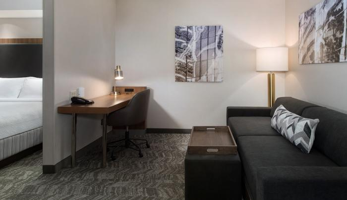 Our guest rooms feature a living area with sofa bed and work desk