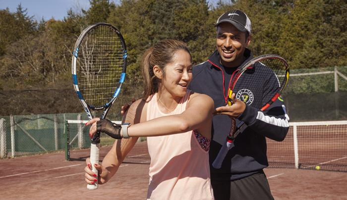 Tennis Pro with student