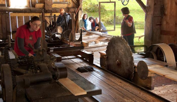 Seeing the historic water-powered sawmill in action is a highlight of the tour.