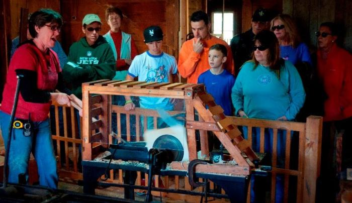 See century-old water-powered woodworking machines in operation at Hanford Mills Museum.