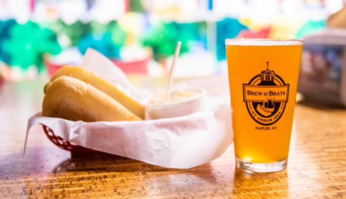 Closeup of a cold beer and a meal at Brew and Brats