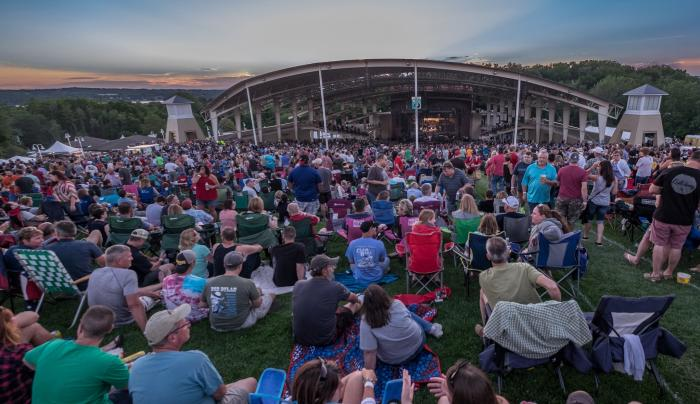 Photo of viewers sitting on the lawn at the CMAC Center in Canandaigua