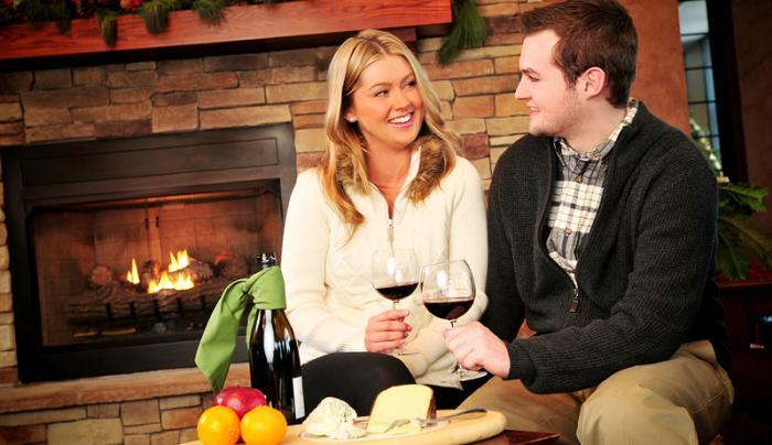 finger-lakes-belhurst-geneva-vasiliy-couple-toasting-wine-with-cheese