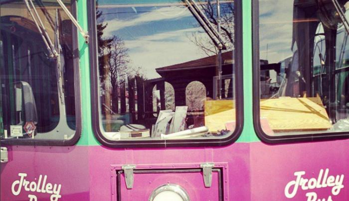 Exterior of the pink trolley bus at Finger Lakes Winery Tours