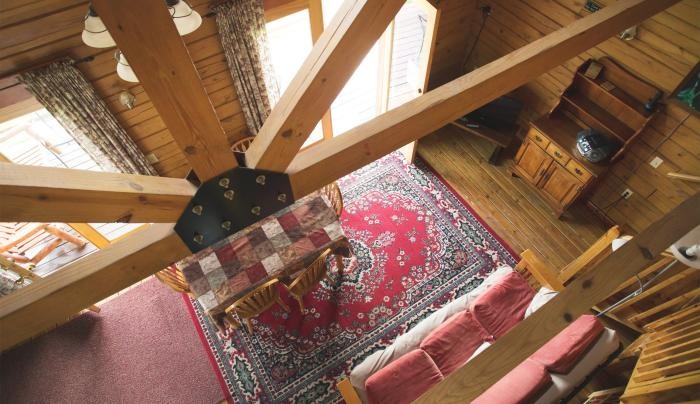 Photo from the loft looking down to the living room in the Hemlock cottage
