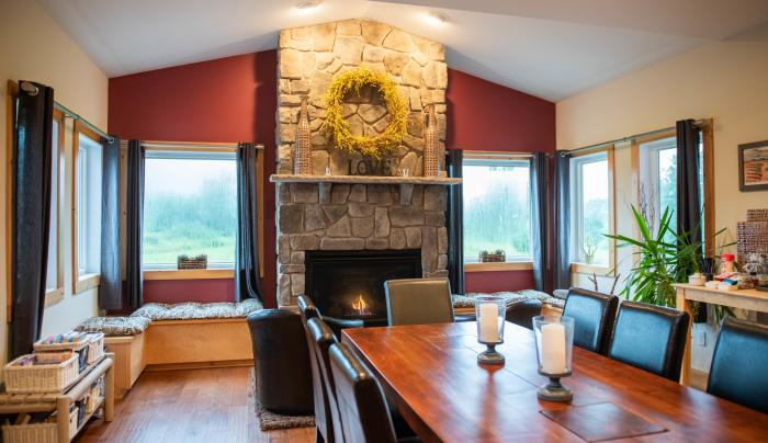 Interior of the dining area and fireplace at Mountain Horse Farms in Naples