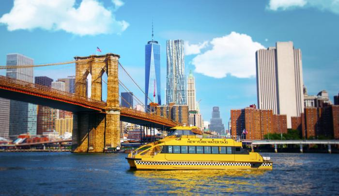 New York Water Taxi in the east river with brooklyn bridge in the back ground