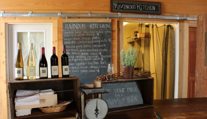 Items sit on shelves for sale inside of The Ravenous Kitchen in Geneva