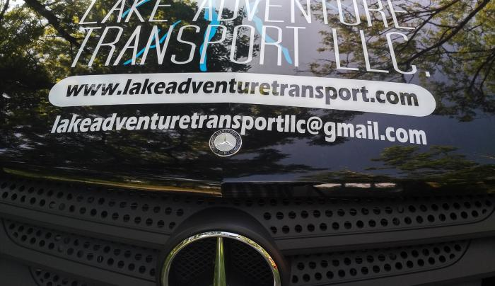 Lake-Adventure-Transport-Vehicle-logo-grille