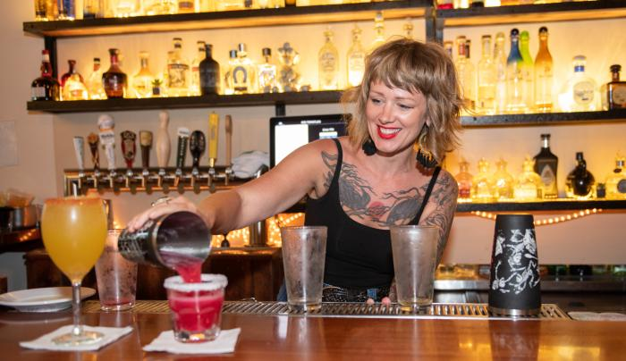A bartender pours drinks at Rio Tomatlan in Canandaigua