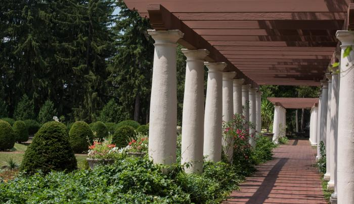 Large marble columns line a walkway at Sonnenberg Mansion in Canandaigua