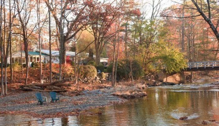 The Woodstock Inn on the Millstream in the fall