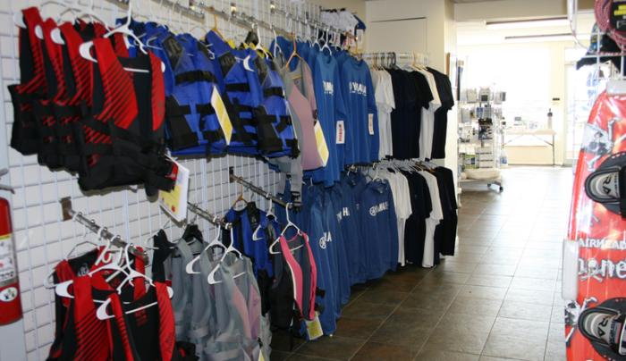 Water clothing hangs from racks inside of Sutters Marina in Canandaigua