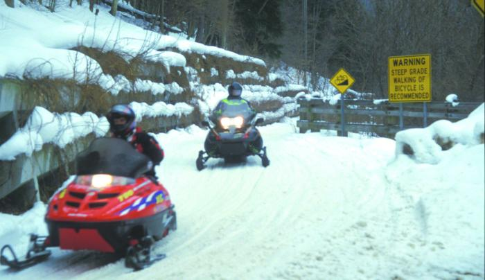 ASP Snowmobile on Trail.jpg