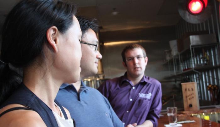 Enjoying good conversation and great beer at the bar at Twisted Rail