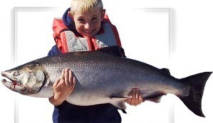 Boy with large fish