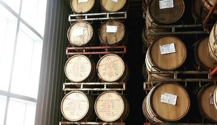 Barrels hold aging bourbon and whiskey