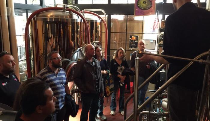Learning how beer is made. *Photo credit: Nick Whitmer