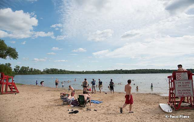 Beachgoers enjoy partly sunny day on one of Madison's lakes