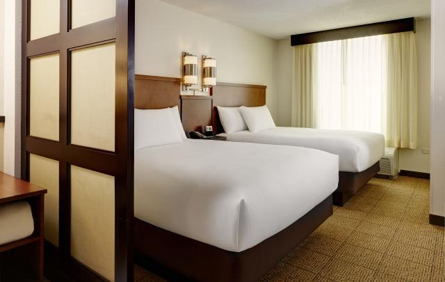 A two-queen bed room at Hyatt Place Madison