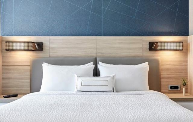 A bed at SpringHill Suites by Marriott