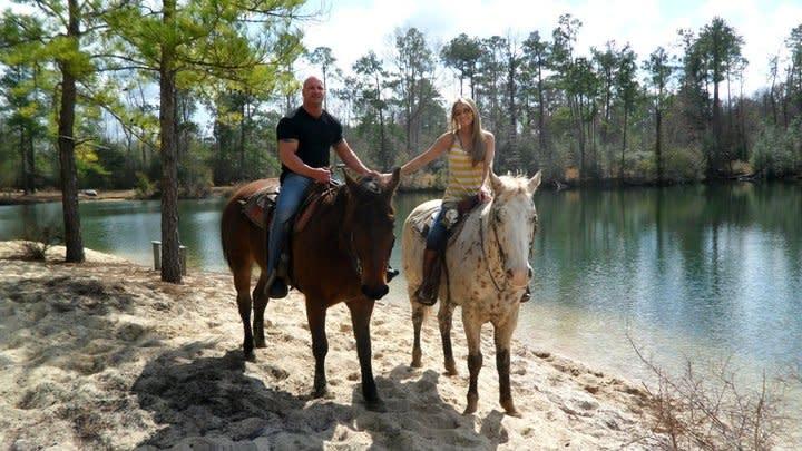 Couple Trail Riding at Splendor Farms