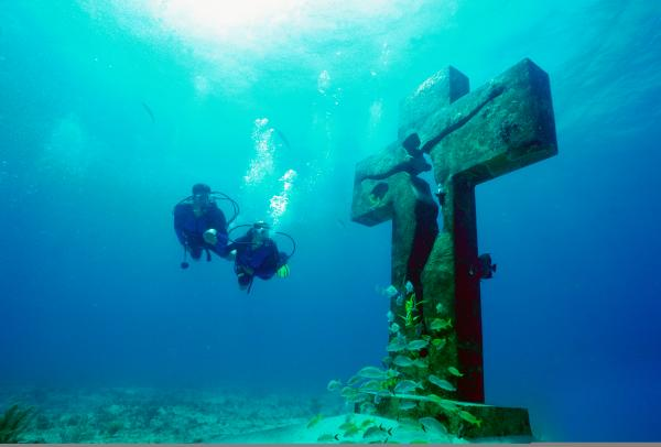 Divers by Underwater Statue