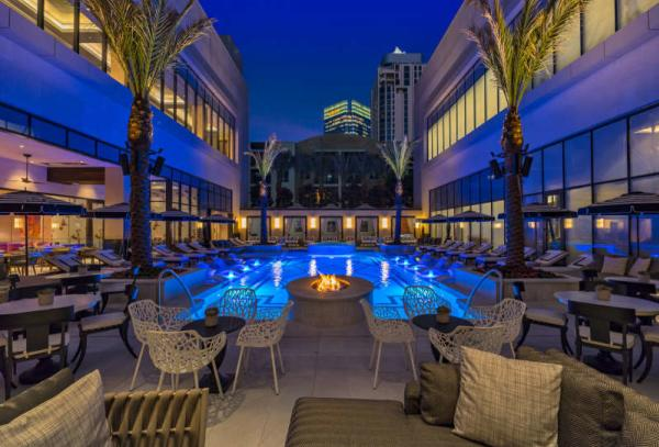 The pool and courtyard at Post Oak Hotel Uptown Houston
