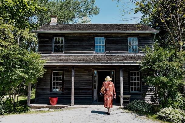 woman walking into uncle toms cabin