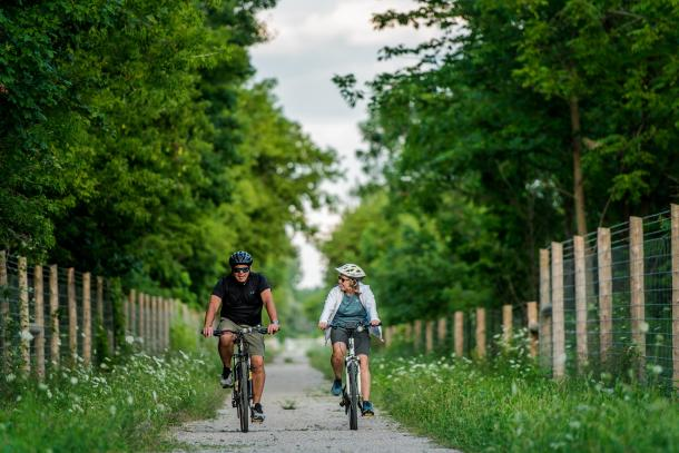 couple cycling on trail