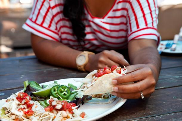 woman eating tacos