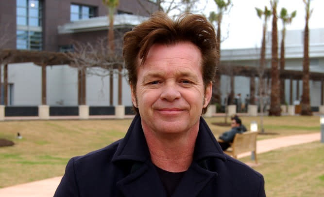 Musician John Mellencamp poses in front of the camera