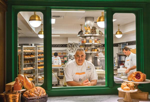 1886 Cafe and Bakery chef looking through the window