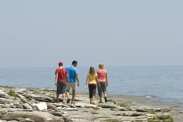 family walking on stone road alvar trail