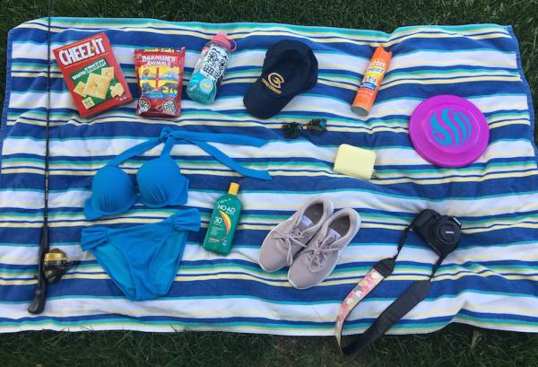Beach towel with items spread out a day trip to Big Falls
