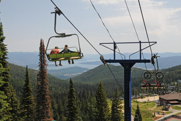 Couple enjoys the scenic view of Lake Pend Oreille from Schweitzer's Great Escape Quad.