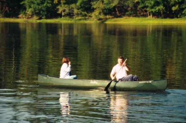 couple in canoe on University Lake Chapel Hill
