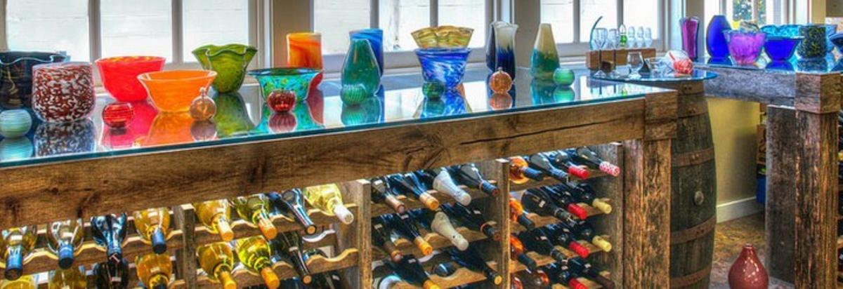 artisan glassware and wine bottles display from Crafted in Haymarket