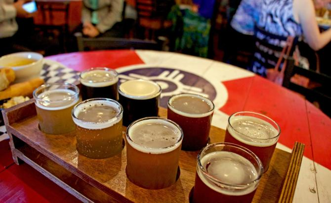 Eight samples of craft beer are served to a table at River City Brewing Co in Wichita