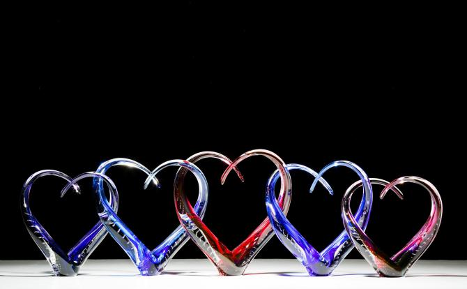 Five hearts made of glass are intertwined for a creative art piece