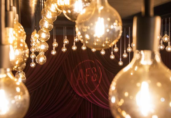 Lights and logo on red curtains at AFS Cinema