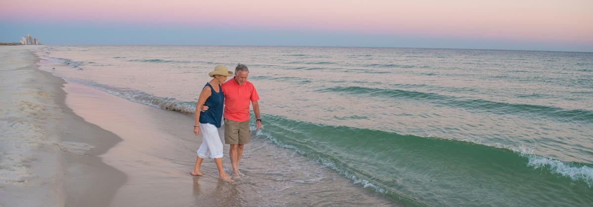 couple-walking-on-beach-at-dusk