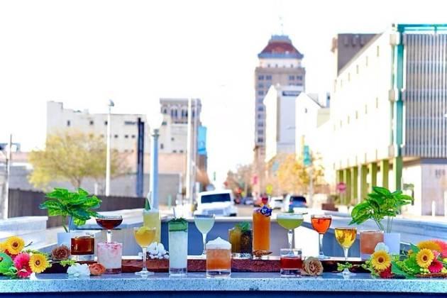 Modernist drinks against downtown skyline