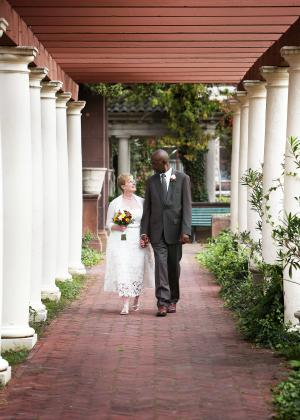 A couple walks down the Isle at Sonnenberg Gardens