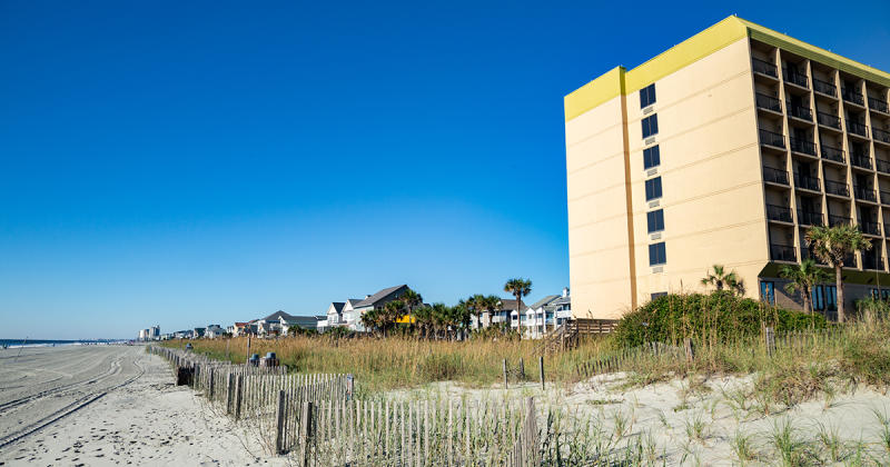 Beach in Surfside Beach with beach home and hotel